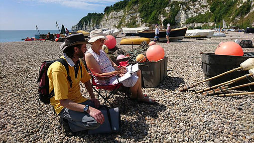 Image of Nick Watton teaching on a sketching workshop on the beach.