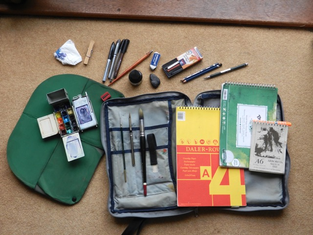 A sketching set, including sketchbooks, small paintset, pens and pencils.