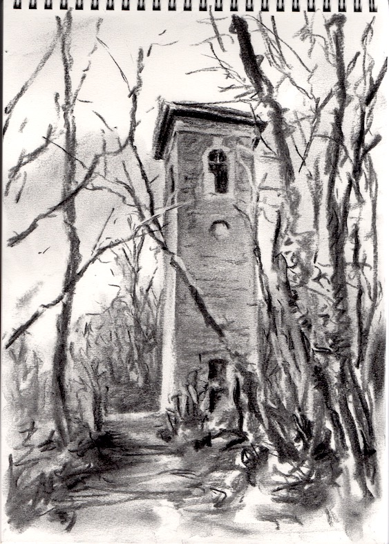 Image of a stone built Tower sticking out of the surrounding trees. Which shows the destination of the walk.