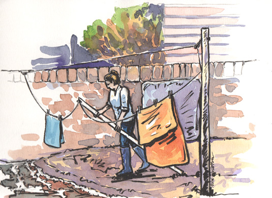 Pen and watercolour sketch of the washing being hung up on the beach at Lympstone.