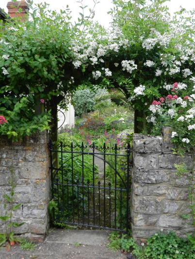 Photo looking through a gateway into a Spring Garden